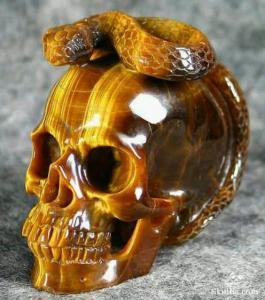 ojo de tigre tallado amuleto